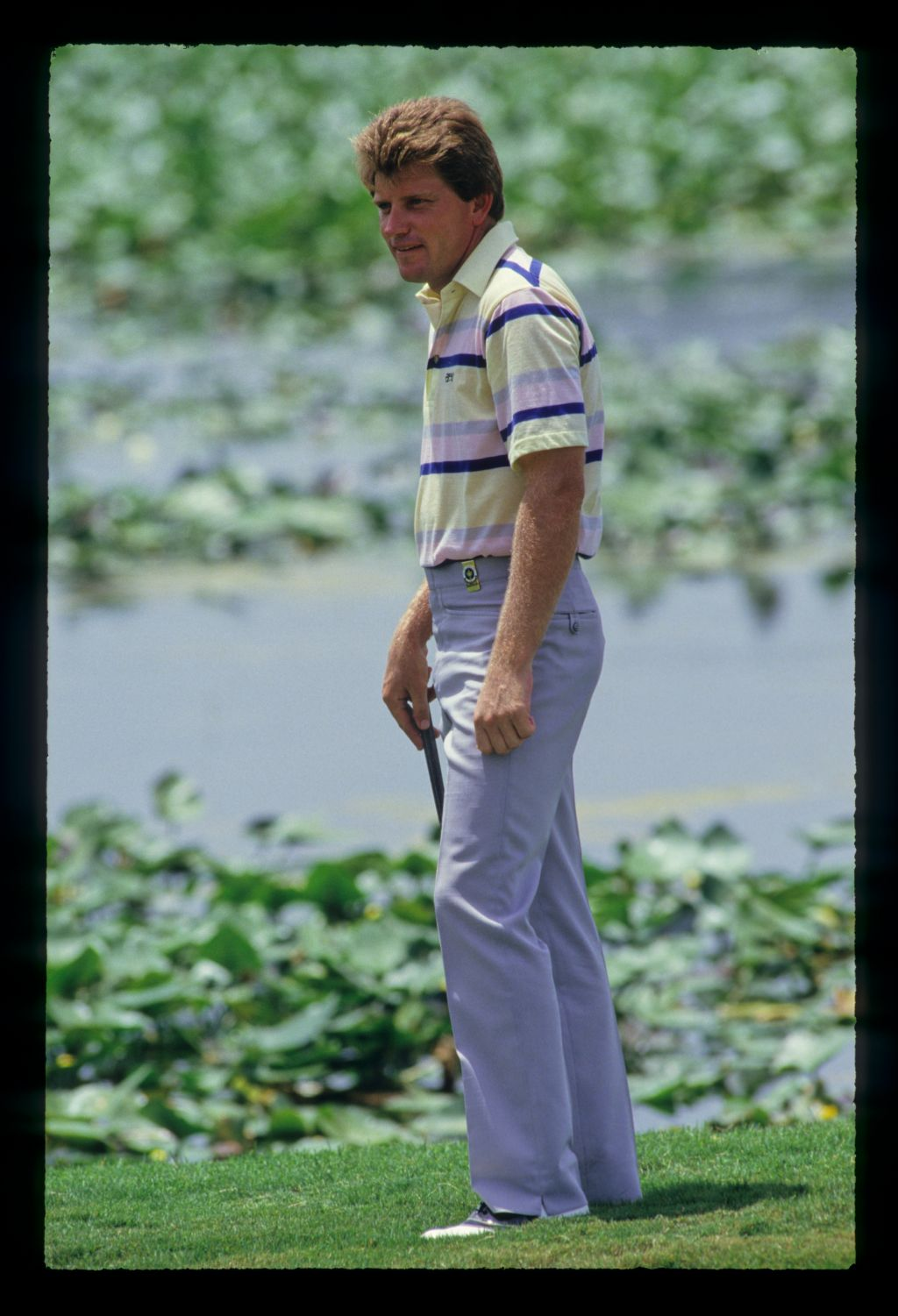 Nick Price looking thoughtful down by a water hazard during the 1987 USPGA