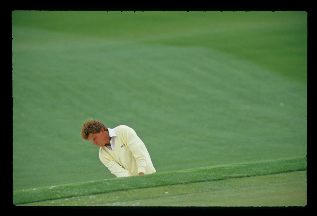 Nick Price preparing to hit from a bunker during the 1988 Masters