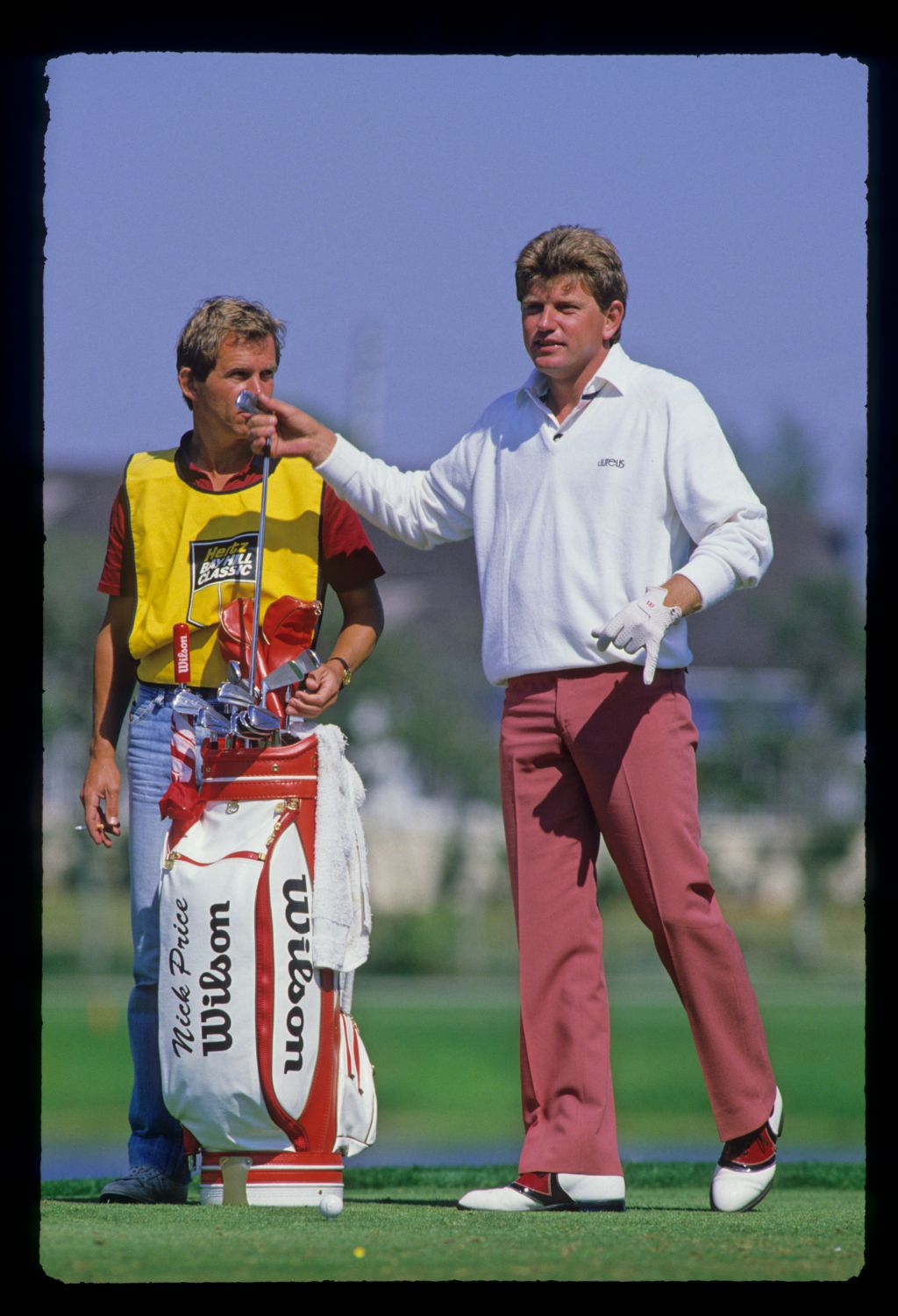 Nick Price and his caddie making their club selection on the tee during the 1987 Hertz Bay Hill Classic