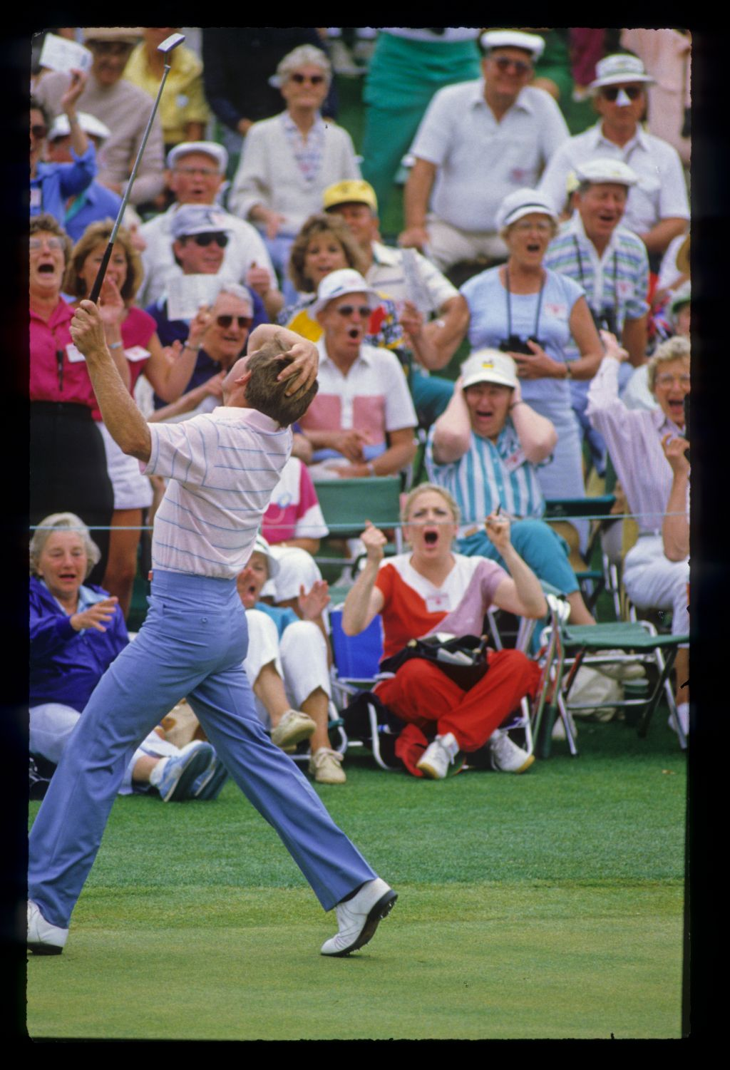 Nick Price and the patrons celebrating a record breaking round of 63 during the 1986 Masters
