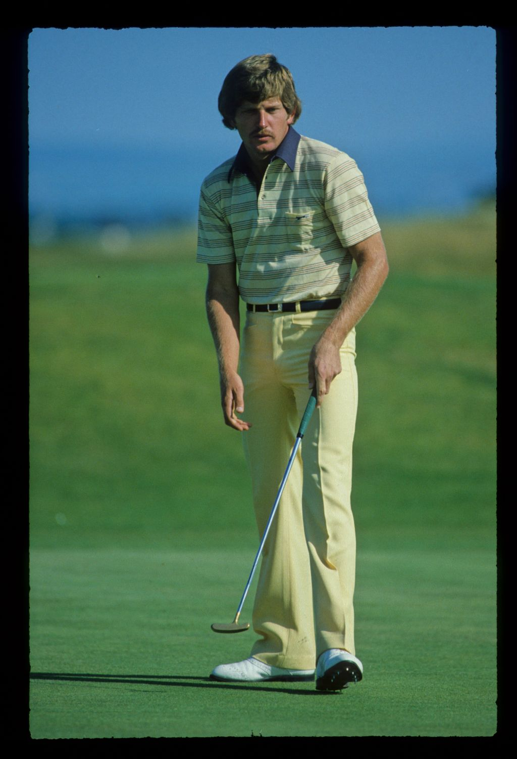 Nick Price with a moustache stepping after a putt on his way to third place during the 1982 Open Championship