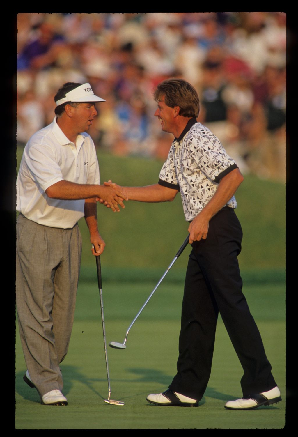 Nick Price being congratulated by Mark O'Meara after winning the 1993 TPC