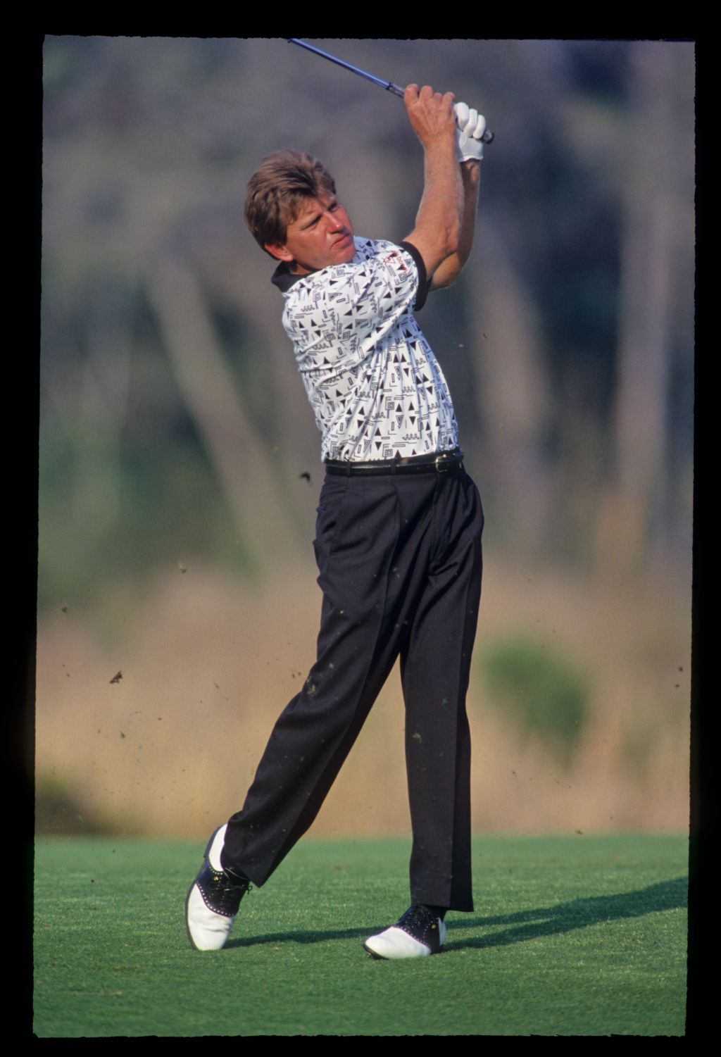 Nick Price hands high on his way to winning the 1993 TPC