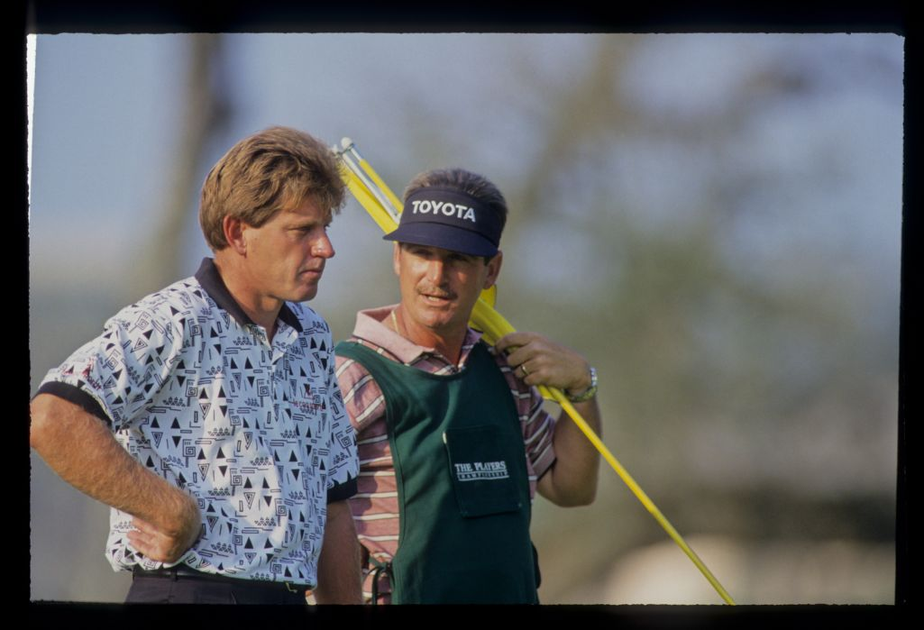 Nick Price and his caddie considering a putt on his way to winning the 1993 TPC