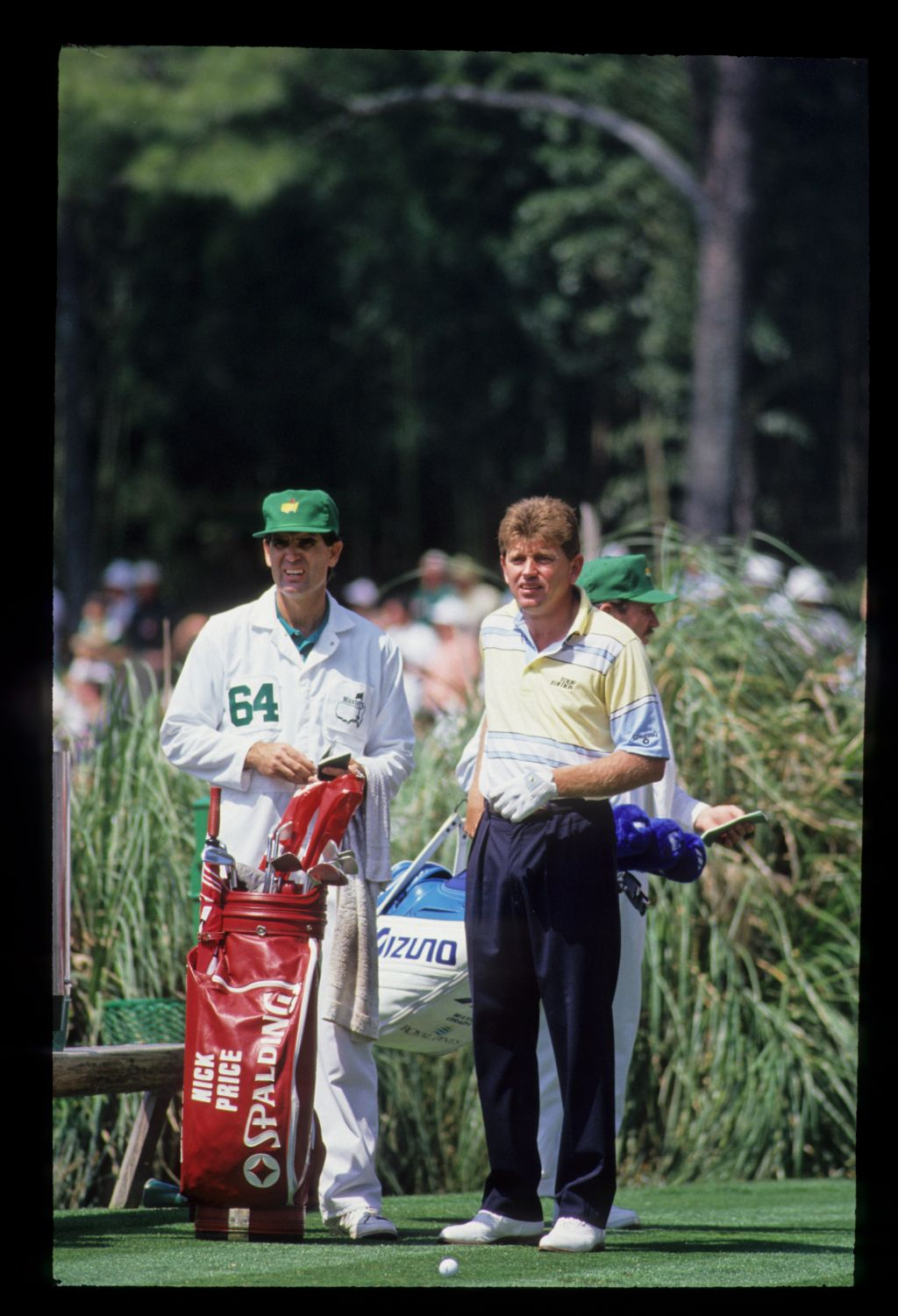 Nick Price and his caddie considering distances on the tee during the 1992 Masters