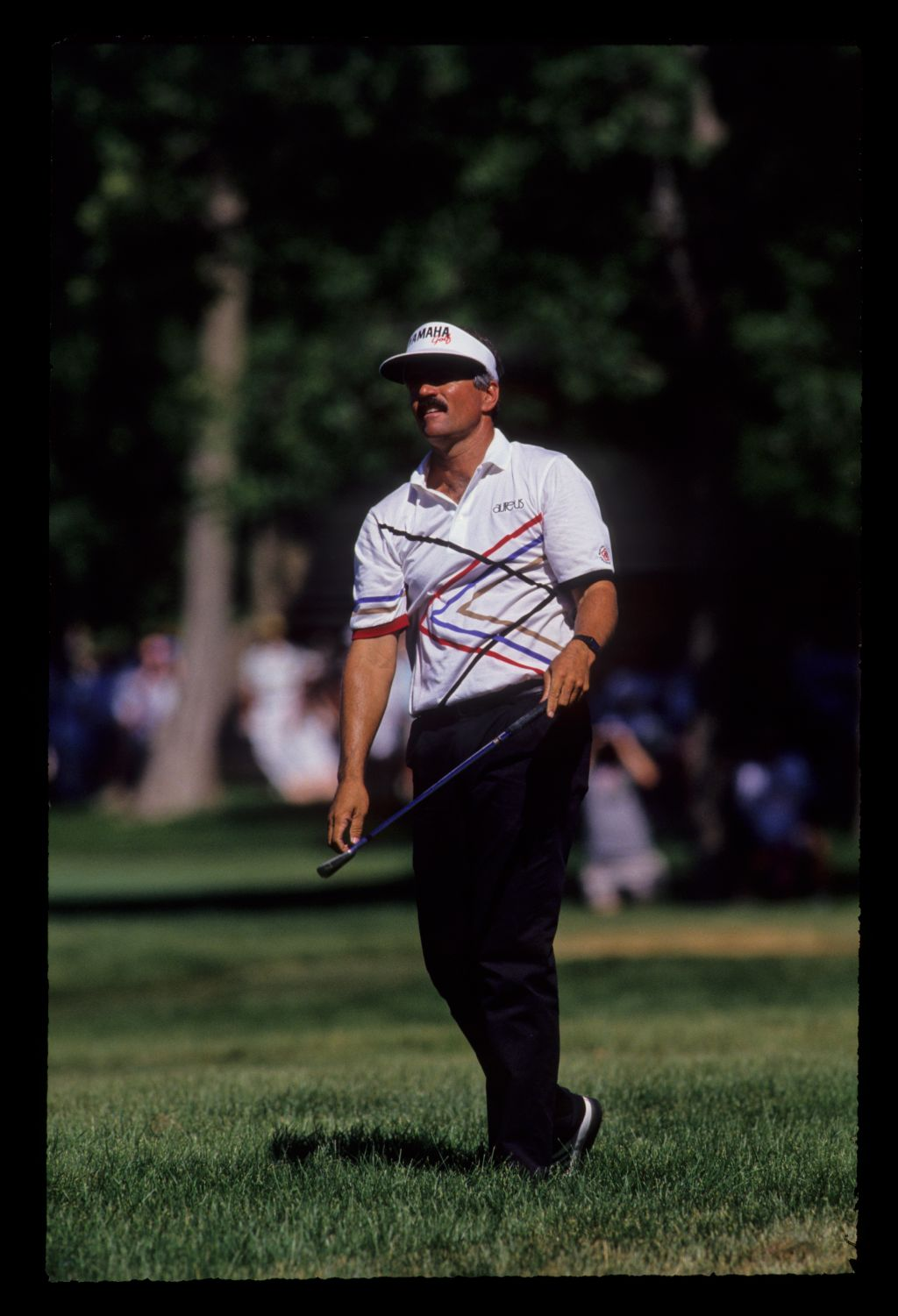 Scott Simpson looking concerned after hitting seven iron from the rough during the 1991 US Open