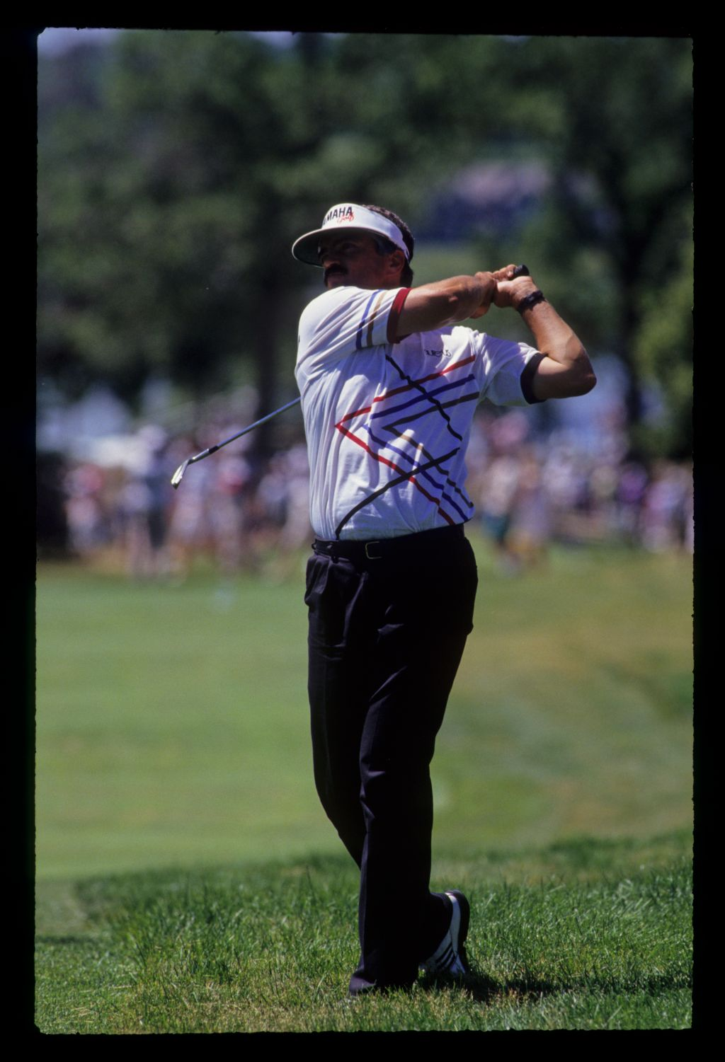 Scott Simpson following through after hitting seven iron from the rough during the 1991 US Open