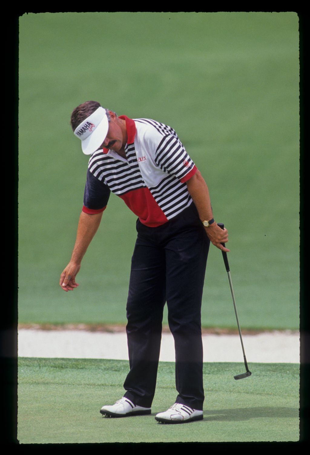 Scott Simpson willing his putt to drop during the 1991 Masters