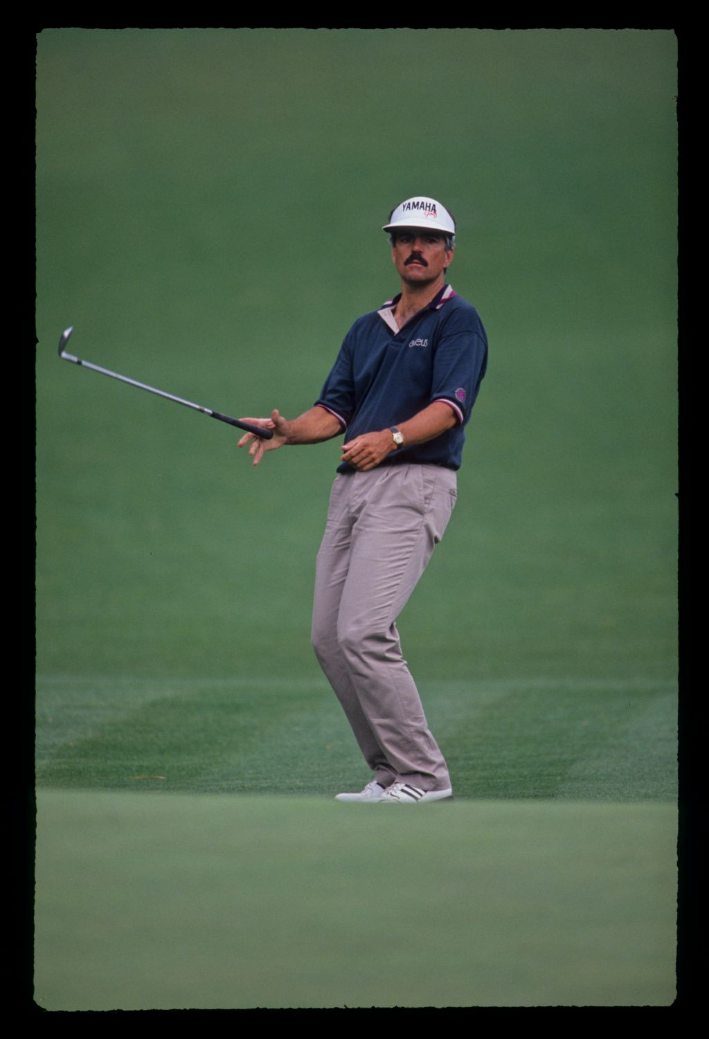 Scott Simpson dropping his wedge after chipping to the green during the 1991 Masters