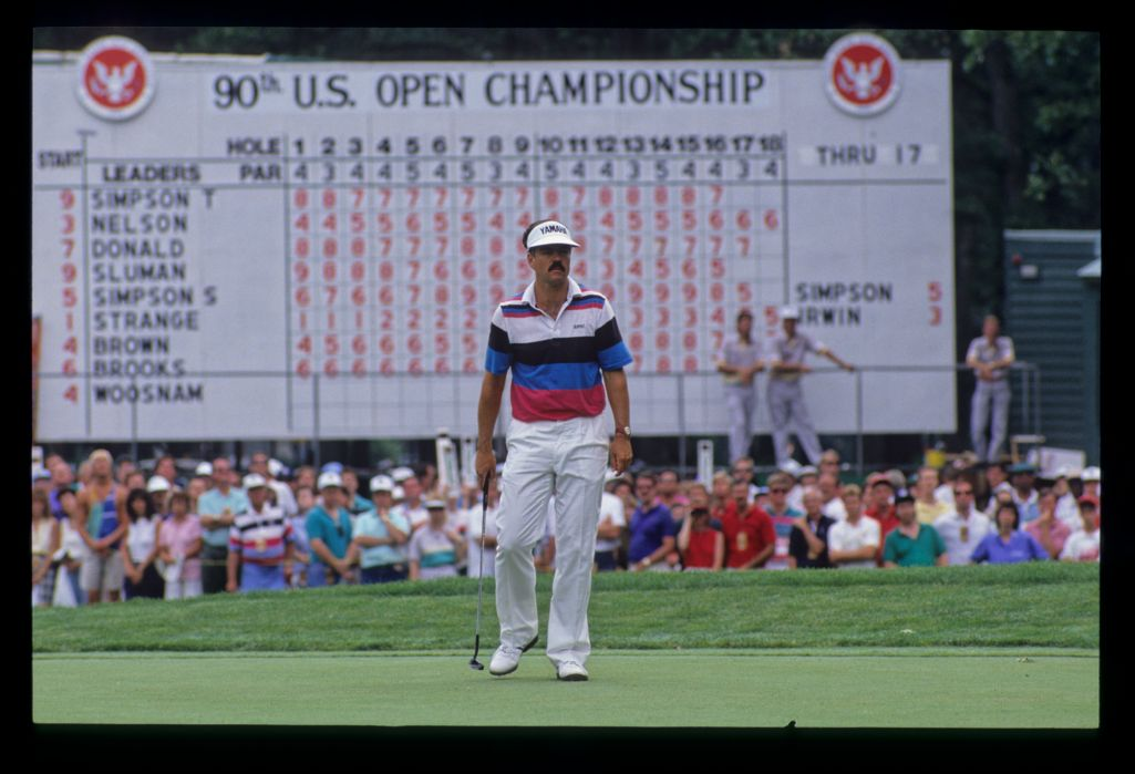 Scott Simpson stepping after a putt from in front of the scoreboard during the 1990 US Open