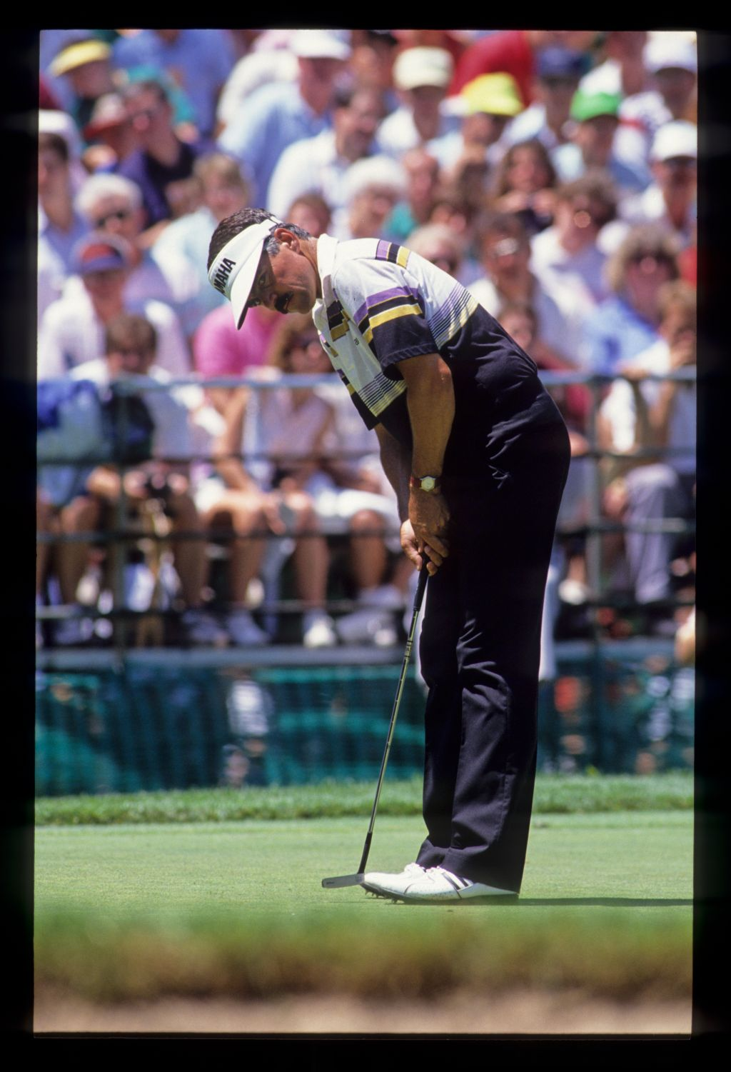 Scott Simpson putting during the 1990 US Open