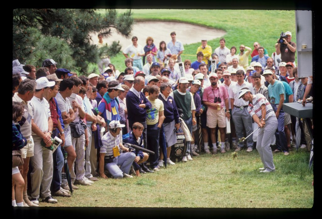 Scott Simpson hitting from the rough among the gallery during the 1989 US Open