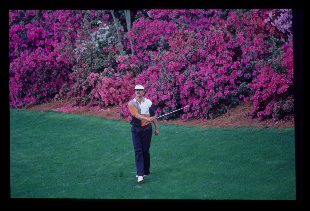 Scott Simpson waving his sand wedge after hitting from in front of the azaleas during the 1992 Masters