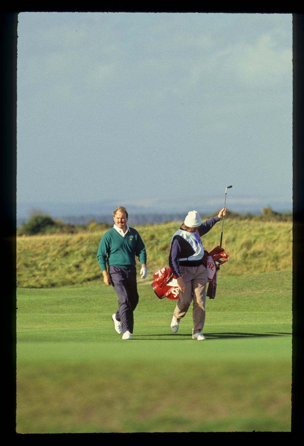 Ronan Rafferty and his caddie walking the fairway on the way to victory at the 1990 Dunhill Cup
