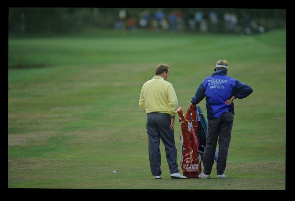 Ronan Rafferty making his club selection on the fairway during the 1989 Suntory World Matchplay