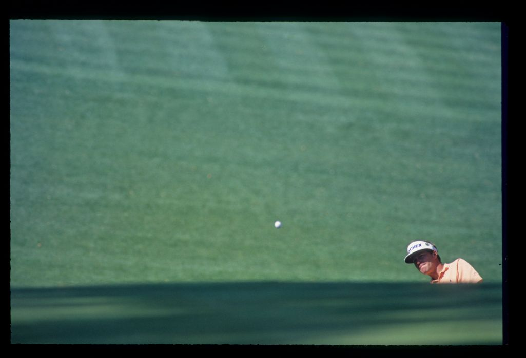 Jeff Sluman almost invisible as he splashes from a deep bunker during the 1993 Masters