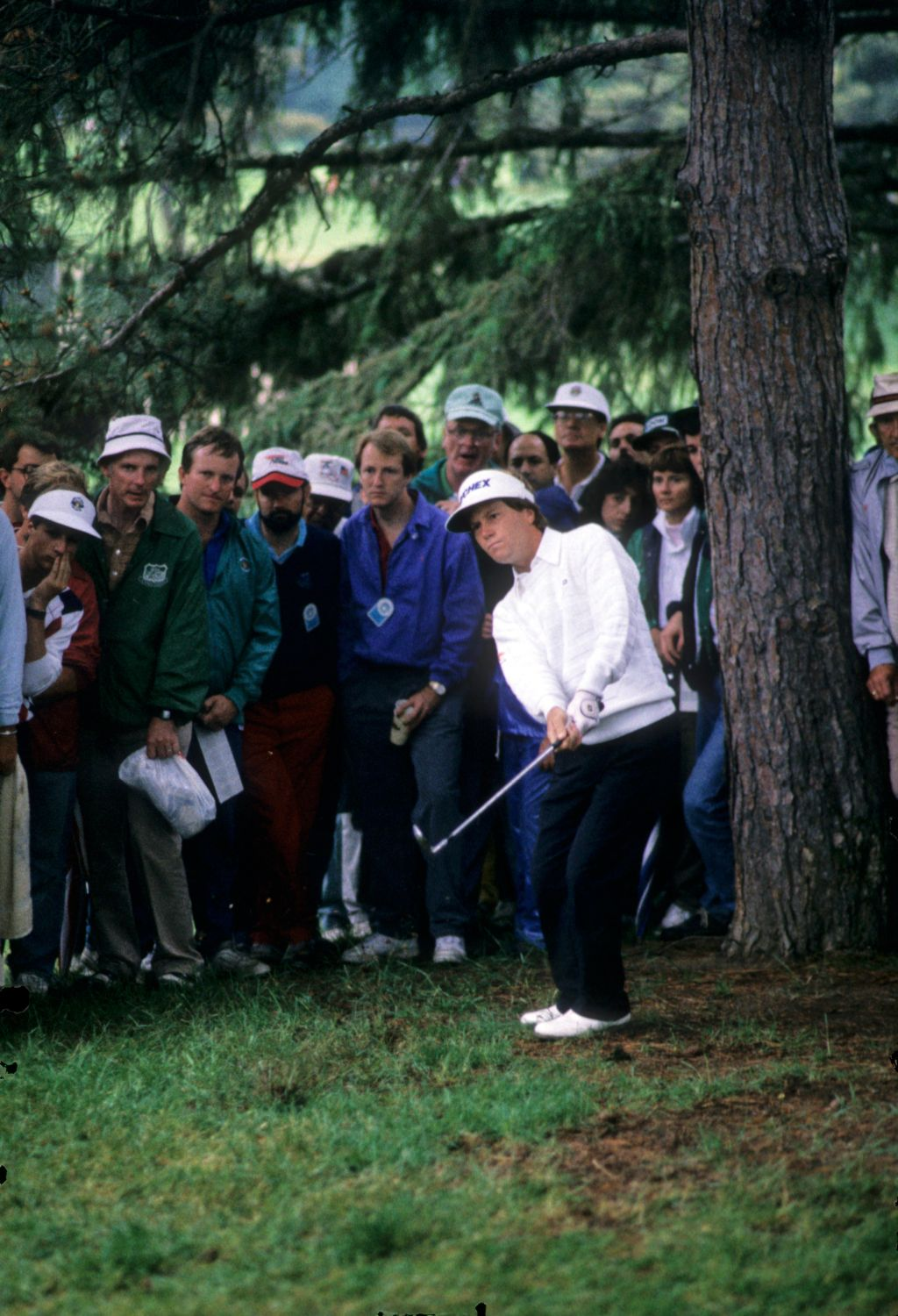 Jeff Sluman hitting from the trees during the 1989 US Open