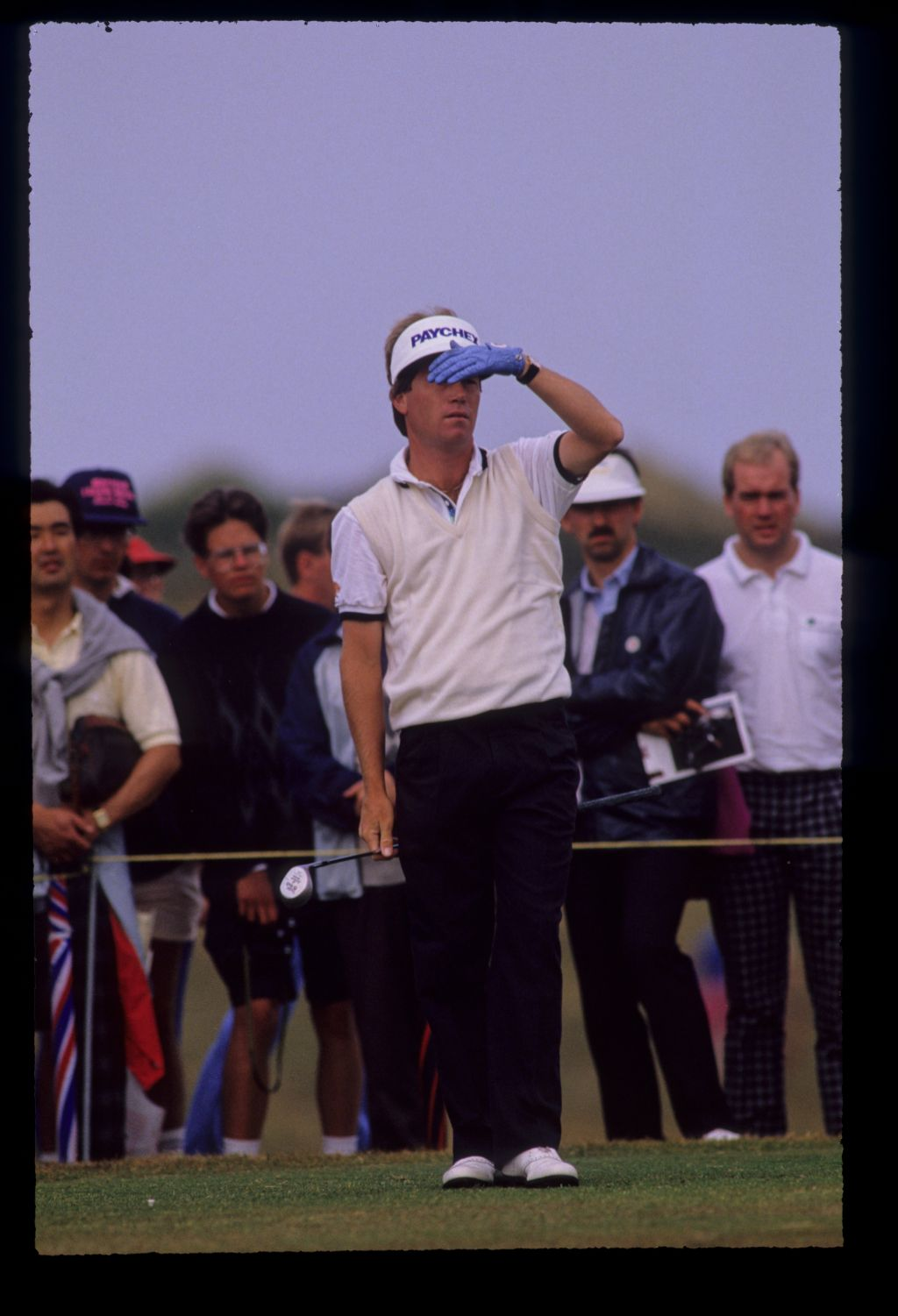 Jeff Sluman shielding his eyes from the sun during the 1989 Open Championship