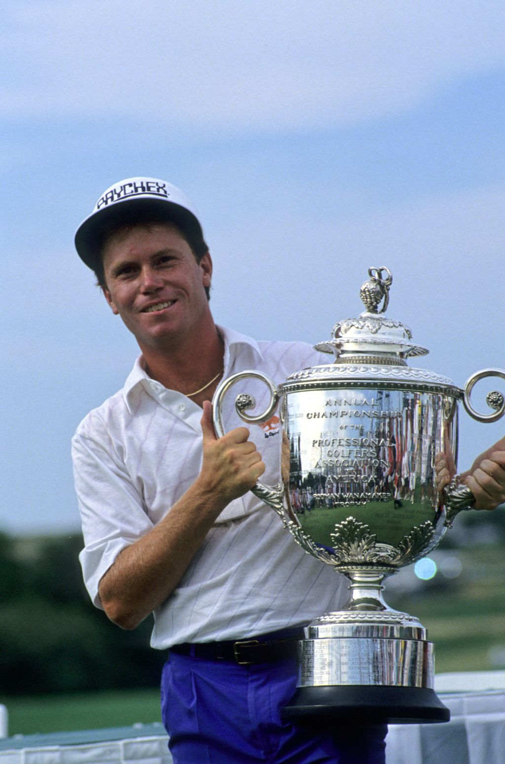 Jeff Sluman holding up the huge trophy after winning the 1988 USPGA