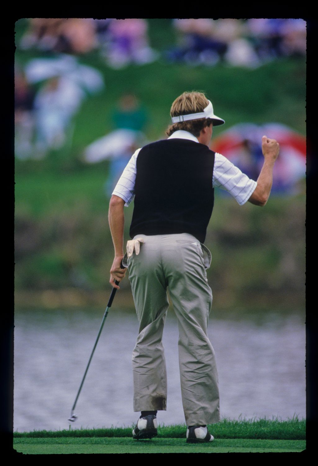 Jeff Sluman with a clenched fist salute after a successful putt during the 1987 TPC
