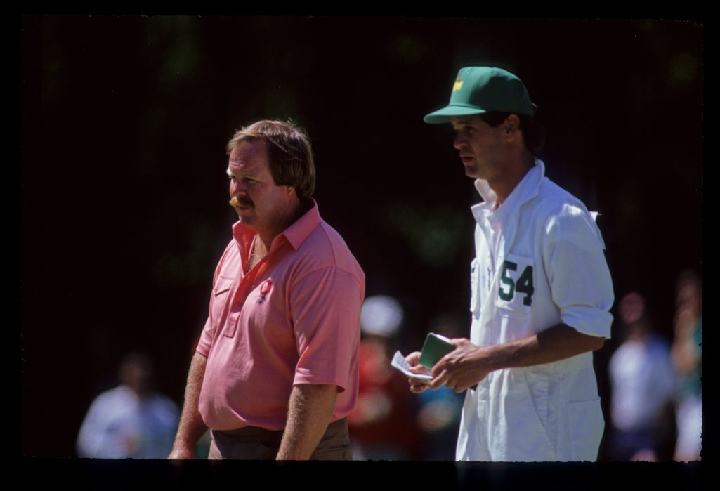 Craig Stadler and his caddie considering their options on the green during the 1990 Masters