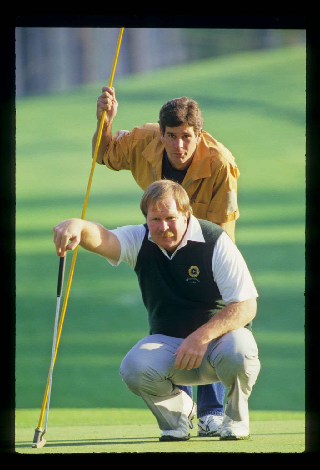 Craig Stadler and his caddie considering the line of a putt during the 1988 TPC