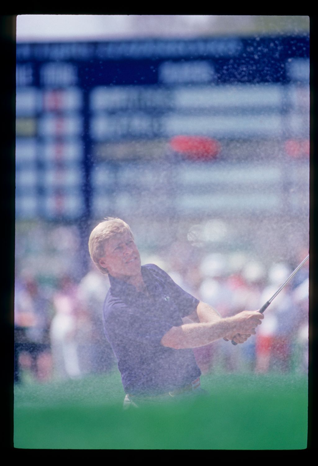 Hal Sutton splashing from a bunker during the 1984 TPC