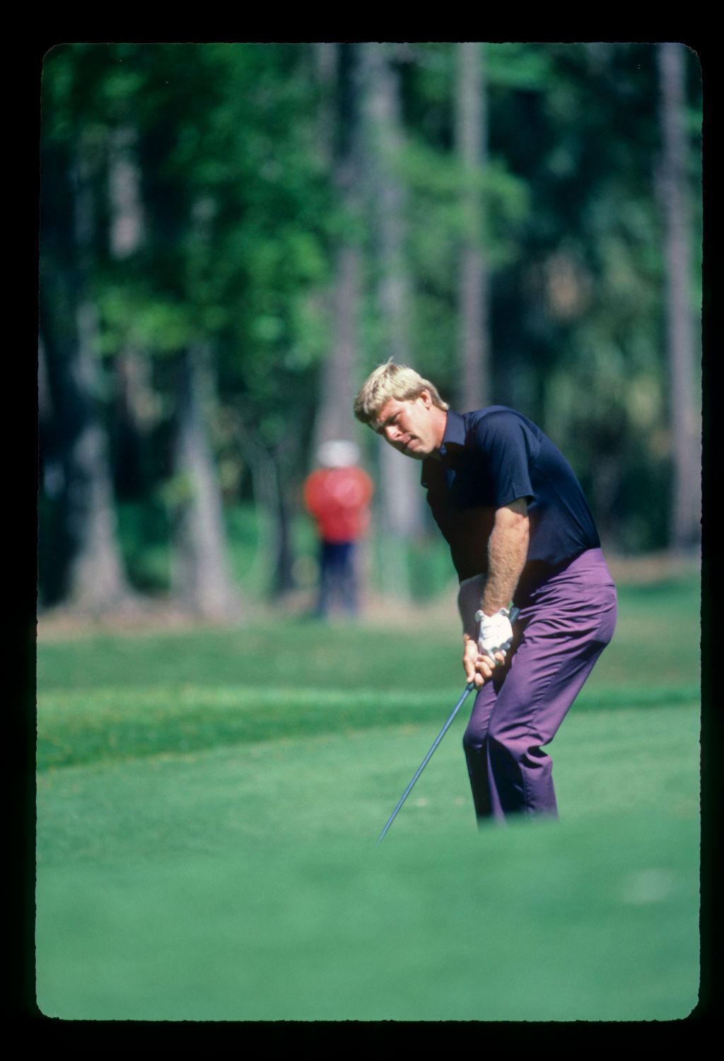 Hal Sutton pitching to the green during the 1984 TPC
