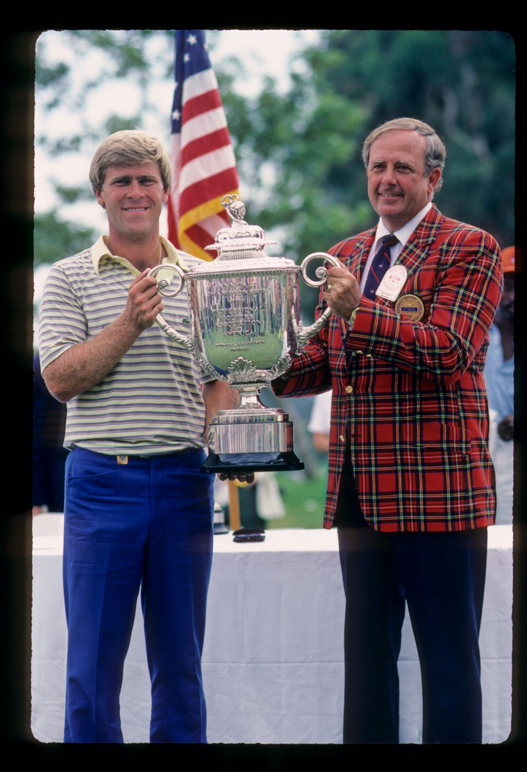 Hal Sutton receiving the trophy after winning the 1983 USPGA