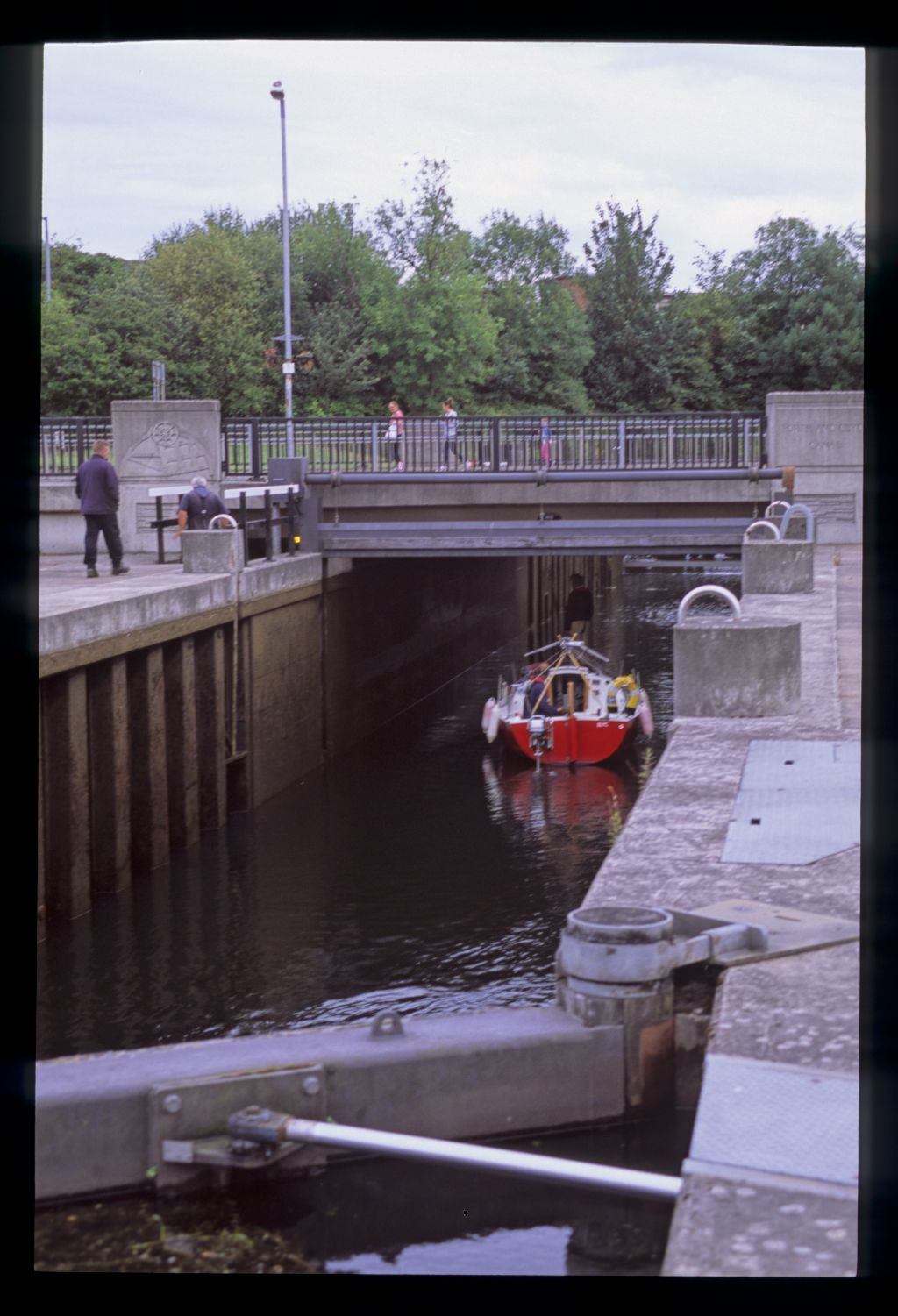 In the Dalmuir drop lock, sailing under a busy main road! Forth and Clyde Canal, Glasgow.