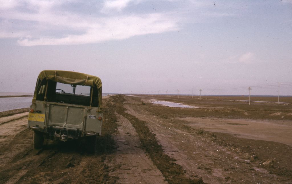 Car parked alongside coast near the marshlands of Southern Iraq