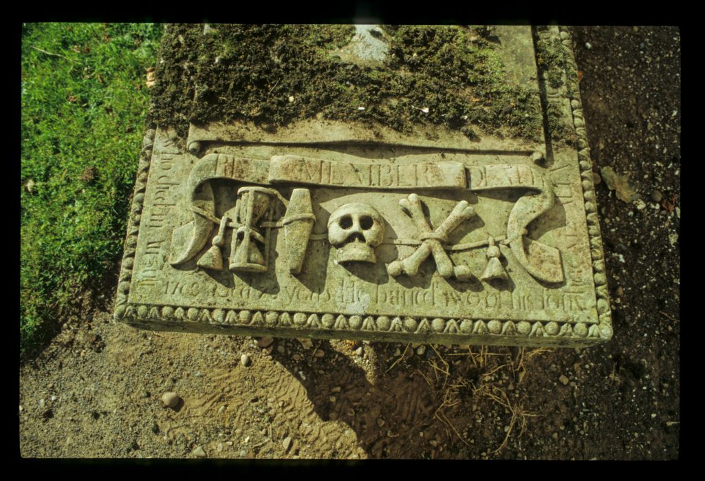 An ornate table tombslab with with symbols carved at end, Inverarity.