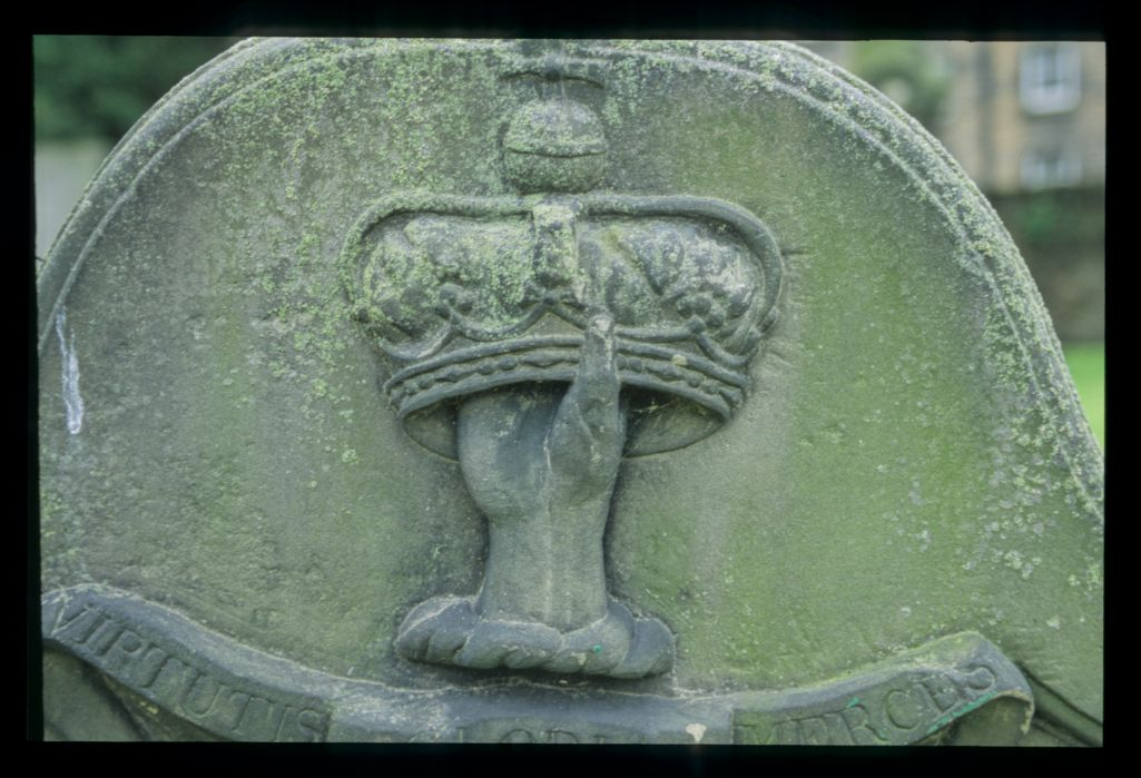 Hand holding up a Crown of Life, gravestone top, South Leith.
