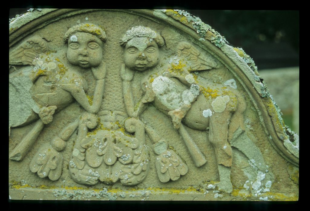 Listening for an echo? Gravestone top with two angels holding Trumpets of Resurrection, Maryton, Old Montrose.