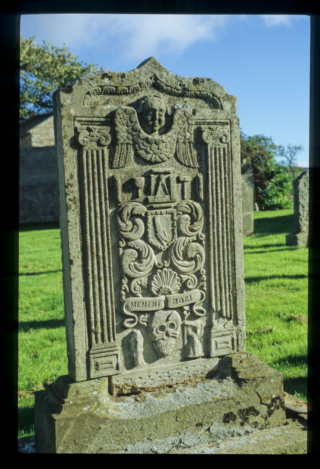 The symbols/tools of a mason and farmer on a gravestone, Collace.