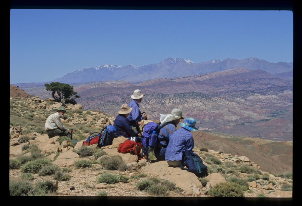 A group (of trekkers) above the plain and distant hill (South Telouet).