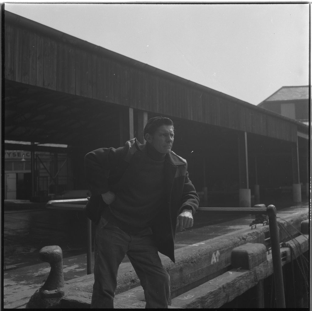 [A man stands looking at the docks, South Shields fishing docks]