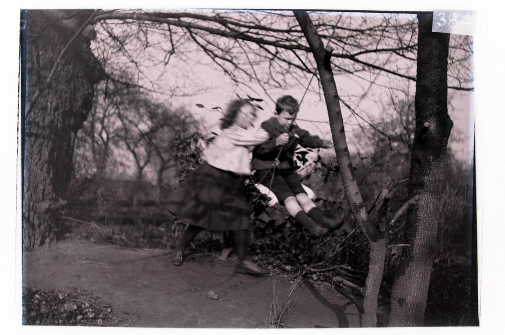 [Ida pushing Fred Miller on the swing in the garden, Cleveland Cottage, Isleworth].