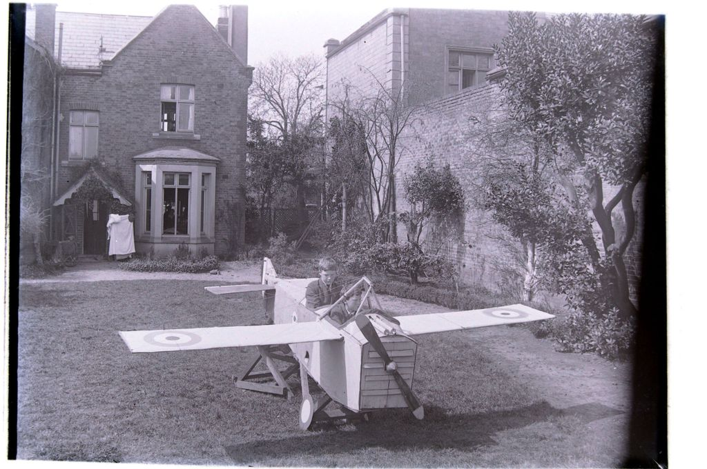 William and Austin Miller [prepare to take flight in the garden at Cleveland Cottage, Isleworth].