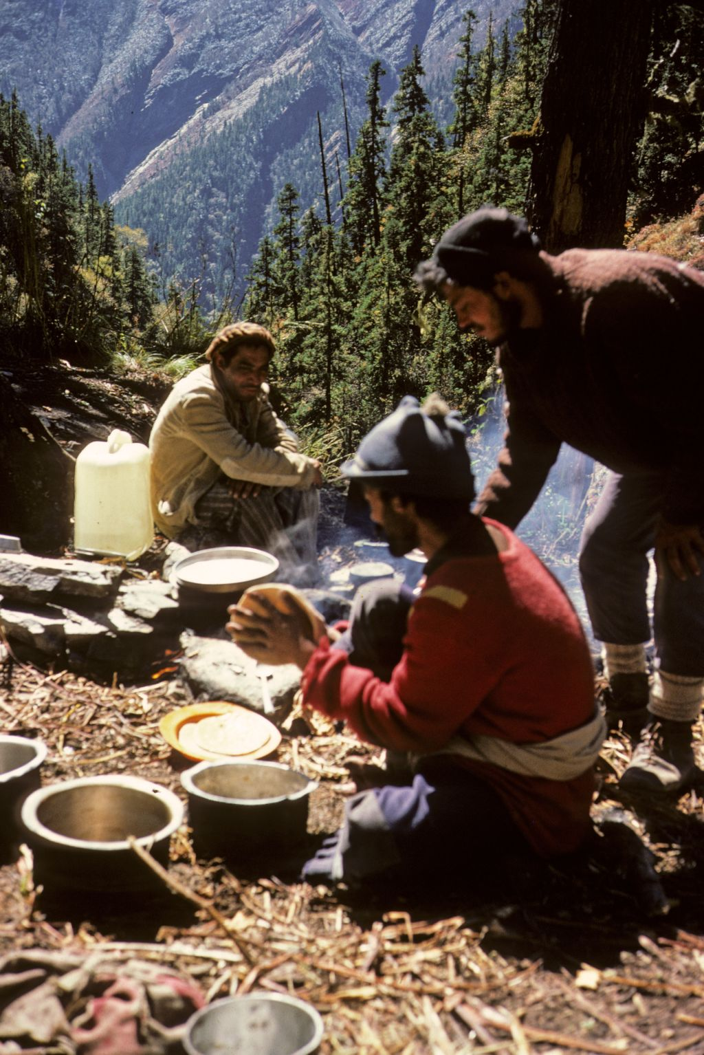 Ri Singh, Sher Singh and porter making chapattis on for supper, Dibrugetta [India]