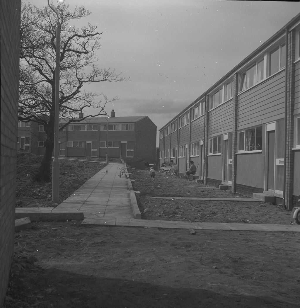 [East Kilbride - Westwood IX development, view of buildings with women and a child]