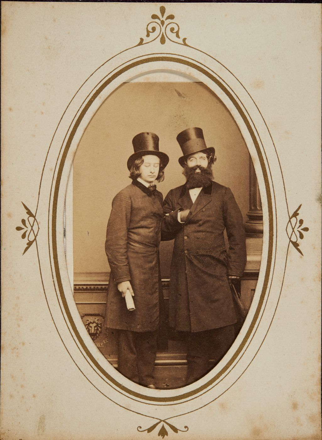 [Two men standing, with top hats and long coats]