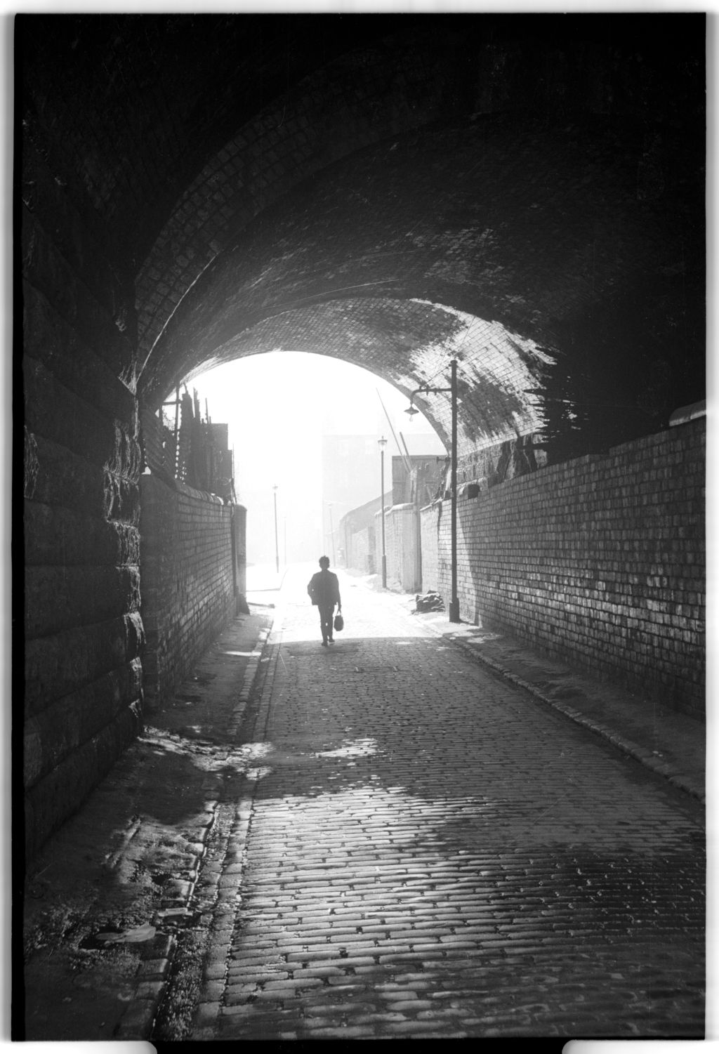 [Cobbled Street Under Railway Bridge]