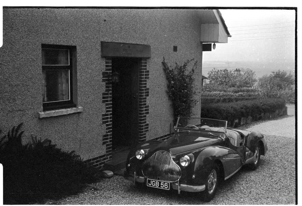[Alvis TB14 Car in front of House]