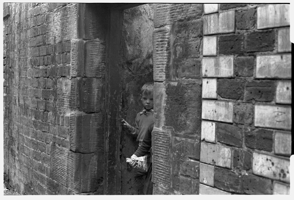 [Children in Doorway of Derelict Building]
