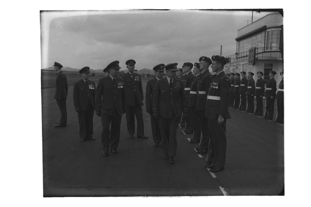 Air Chief Marshal Sir Basil Embry, arriving for for the Investiture of British Empire Medals, inspects the airmen on parade, RAF Leuchars.
