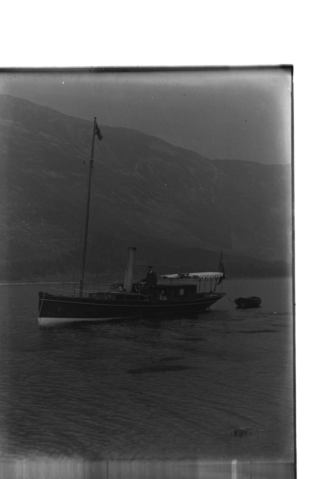 The Launch [Netta with Captain McIntyre at the wheel, Loch Leven].