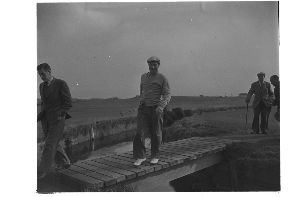 Peter Thomson crossong the Sliwcan Bridge, the Old Course. St Andrews, the Open.