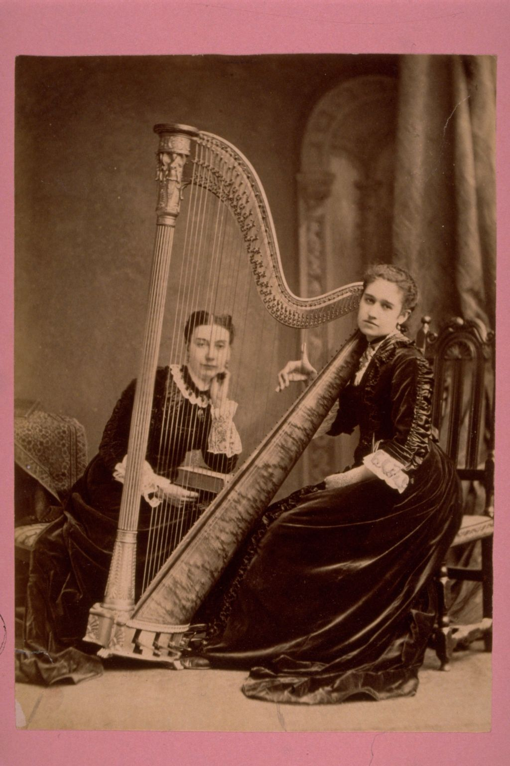 Two unidentified young women with harp.