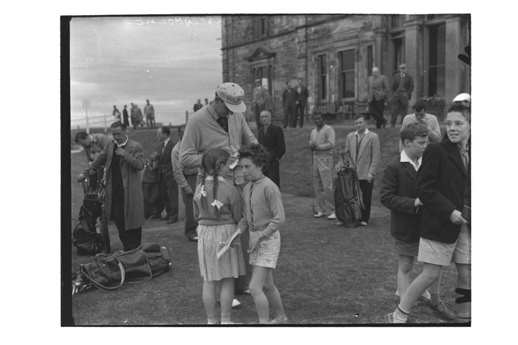 Guy Wolstenholme (Sunningdale) signs autographs for young fans at the 1st Tee on the Old Course, the Centenary Open Championship, St Andrews.